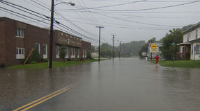Flooding in Barre Vermont: Hurricane Irene. Flooding on North Main Street in the Central Vermont Town of Barre caused by Hurricane/Tropical storm Irene's passage Royalty Free Stock Photo