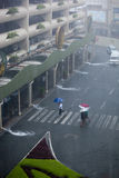 Flooding Caused by Typhoon Ondoy. People cross the roads which are engulfed with rain water from drains Stock Photo