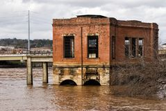 Flooding of the Chattahoochee River in Columbus Georgia USA. Chattahoochee River flooding between Columbus Georgia and Phenix City Alabama. An abandoned historic stock photography