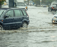 Flooding in the city. On the road royalty free stock image