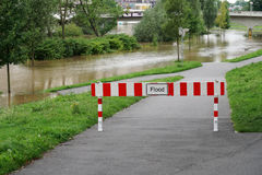 Flooding flood high water. Flood barrier, road blocked due to flooding Stock Images