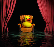 Flooding  interior. Rubber duck on the luxury leather armchair and red curtain above flooding  interior (3D Royalty Free Stock Photography