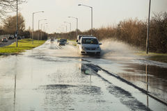 Flooding in Kent. Cars struggle on a road flooded by rain water Stock Photography