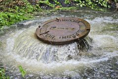 Flooding manhole cover stock photos