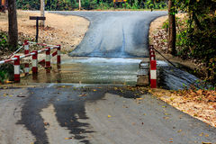 Flooding over the road at national park waterfall Royalty Free Stock Photos