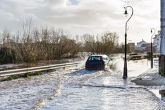 Flooding river in an irish town Stock Photo