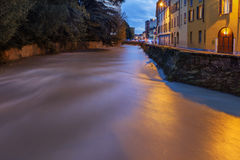 Flooding river. The river Lambro loaded of water due to flooding stock images