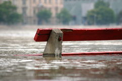 Flooding river. Red bench in flooding river Royalty Free Stock Photography