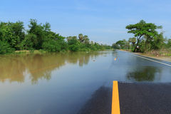 Flooding road. Road blocked by flooding waters Royalty Free Stock Images