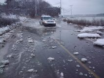 Flooding roads in winter Royalty Free Stock Photo