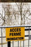 Flooding sign Access closed France. Flooded banks and the swollen Seine river. France on alert after days of heavy rains. Several areas on the Paris city's stock photo