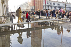 Flooding in St Marks Square. Venice, Italy - Oct 27 2011: Raised walkways during flooding in St Marks Square, Venice.St Marks Square is not far above sea level Stock Image