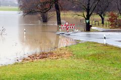Flooding. Street closed because of flooding due to snow melt stock photo