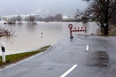 Flooding. Street closed because of flooding due to snow melt royalty free stock images