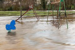 Flooding and swing park. Bad weather with flooding over swing park Royalty Free Stock Images