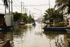 Flooding in  Thailand. Bangkok, Thailand - November 14: The entrance to the Nava Nakorn Industrial Park is a high flood. I need a boat to travel in - from Stock Photos