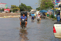 Flooding in Thailand. PRATHUMTHANI, THAILAND - OCTOBER 19: Heavy flooding from monsoon rain in Ayutthaya and north Thailand arriving in Bangkok suburbs on Royalty Free Stock Photos