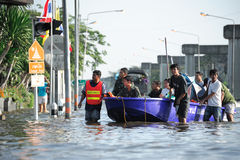 Flooding in Thailand. BANGKOK, THAILAND - NOVEMBER 04: People use boat instead of cars on public roads in Bangkok due to flooding on November 04, 2011 in Bangkok Stock Photos