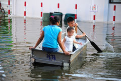 Flooding in Thailand. BANGKOK, THAILAND - NOVEMBER 04: People use boat instead of car on public road in Bangkok due to flooding on November 04, 2011 in Bangkok Stock Images