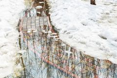Flooding of tile walkpath due to snow melting and rising of water level. Blue sky in puddle reflection.Spring emergency incident. High water or fresget stock image