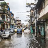 Daily flooded streets after tropical rain in Colon Panama. Flooded streets with cars and people in water and poorly houses, Colon, Panama, Central America Stock Images