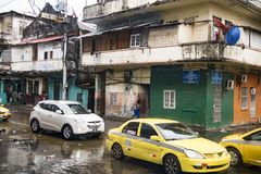 Daily flooded streets after tropical rain in Colon Panama. Flooded streets with cars and people in water and poorly houses, Colon, Panama, Central America Stock Photo