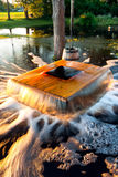 Flooding well. A photo of an old flooding well and a sweep with timber bucket at golden sunlight. The name of the well is Nõiakaev (Witch's well royalty free stock photo