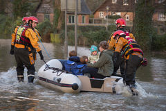 Flooding - Yorkshire - England. Young family being rescued by the fire service after the River Derwent burst its banks in the village of Old Malton in North Royalty Free Stock Image