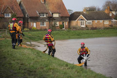 Flooding - Yorkshire - England. Fire Service using high pressure pumps to drain flooding after the River Derwent burst its banks in the village of Old Malton in Stock Image