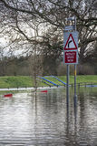 Flooding - Yorkshire - England. Flood water covers a road after the River Derwent burst its banks in the village of Old Malton in North Yorkshire in northeast Stock Image