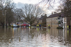 Flooding - Yorkshire - England. Fire Service using high pressure pumps to drain flooding after the River Derwent burst its banks in the village of Old Malton in Stock Images