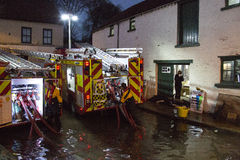Flooding - Yorkshire - England. Fire Service pumping floodwater from a shop after the River Derwent burst its banks in the town of Malton in North Yorkshire in Royalty Free Stock Photos
