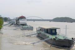 Floodings Bratislava 2013 Danube. Danube river overflowing in Bratislava on the 6th June 2013. Bratislava. Ships anchored at the riverside ports, Old Bridge and Royalty Free Stock Photography
