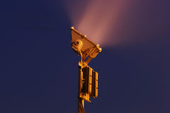Floodlight. A floodlight lit up at night time Stock Image