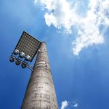 Floodlight on industrial chimney. Floodlight with bounce panel for light, installed on an industrial chimney Royalty Free Stock Photo