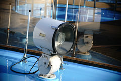 Floodlight at the bow. The close up of a floodlight at the bow of a yacht Stock Images