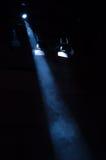 Floodlight. Goes trough smoke on dark background Royalty Free Stock Photography