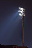Floodlight at stadium. Single floodlight at stadium illuminated at night Stock Photography