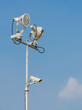 Floodlight. With surveillance cameras in blue sky Royalty Free Stock Image