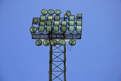 Floodlights. Floodlight against cloudless blue sky at sports stadium Royalty Free Stock Photos