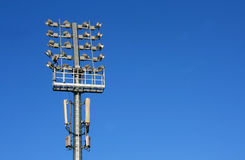 Floodlights. Football stadium floodlights against the sky Stock Image