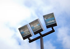 Floodlights. Close up view of Recreation Center Flood Lights Blue Sky Stock Image