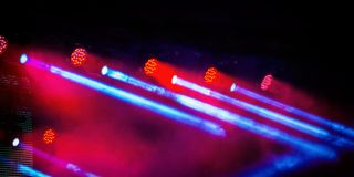 Floodlights scene during a rock concert. Blurred background stock photography