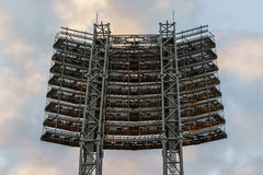 The floodlights at the stadium against the sky with clouds Stock Photography