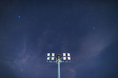 Floodlights on star background Stock Photos