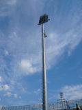 Floodlights. Tall floodlights over football stadium Royalty Free Stock Photography