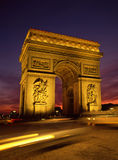 Floodlit Arc De Triomphe Paris. And the Place Charles de Gaulle with traffic trails and sunset Stock Image