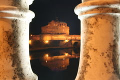 Floodlit castle at night. The floodlit Castel Sant Angelo reflected in the River Tiber in Rome in Italy royalty free stock photography