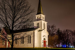 Floodlit Church. A floodlight church on a rainy evening in north-eastern Ohio, USA stock image