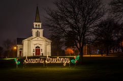 Floodlit Church Seasonal. A floodlight church on a rainy evening in north-eastern Ohio, USA stock photo